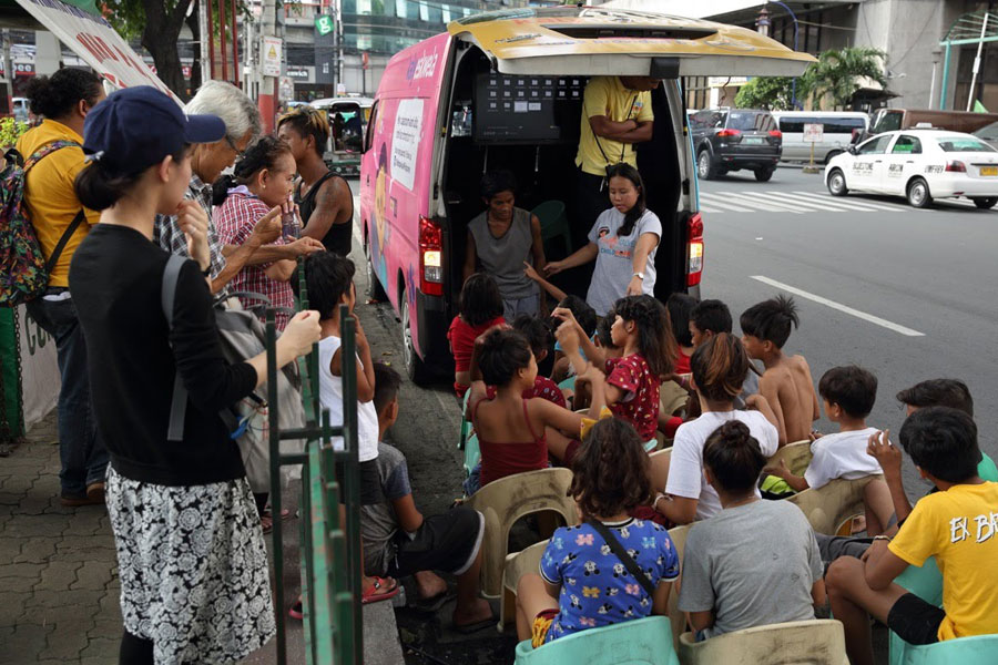 Ongoing street education class with mobile van - street children photos