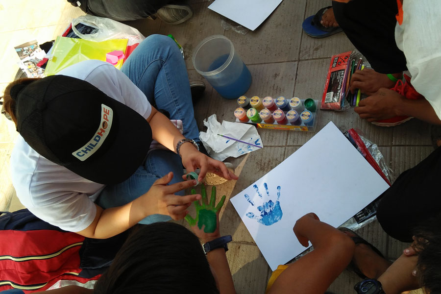 Art class with a volunteer teacher - street education photos