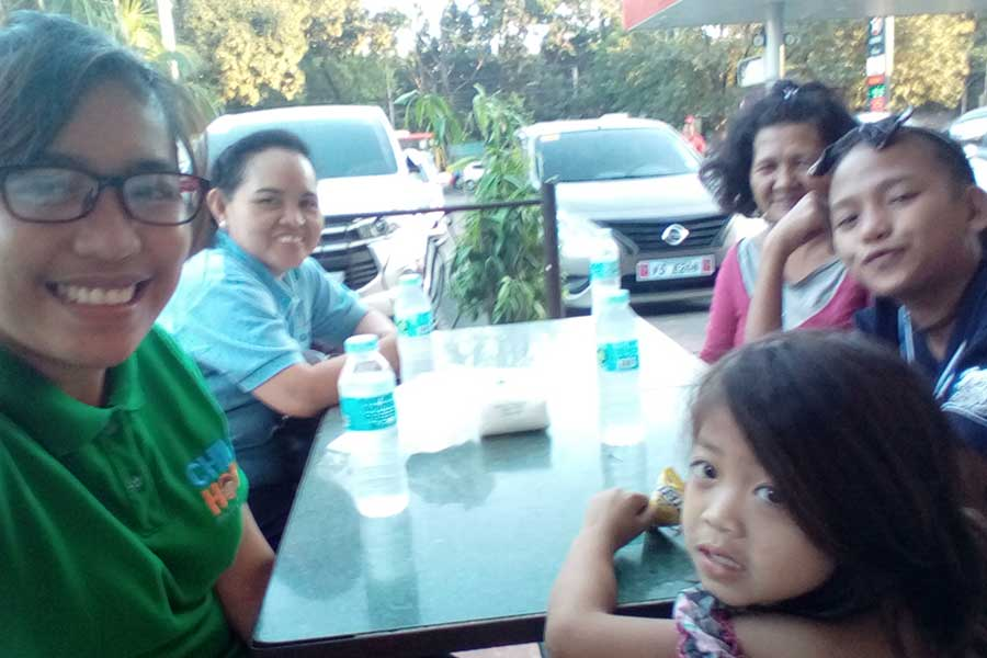 Childhope Philippines staff counseling happy children and parents as a solution on how to help the street children
