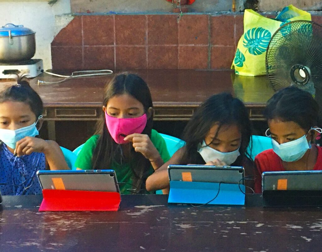 children using tablets for their online learning
