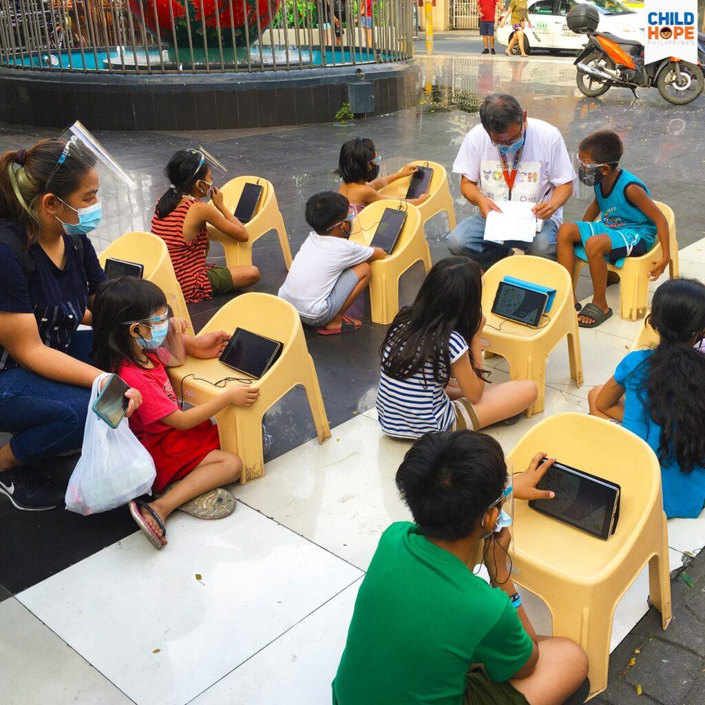 street children using tablets for learning