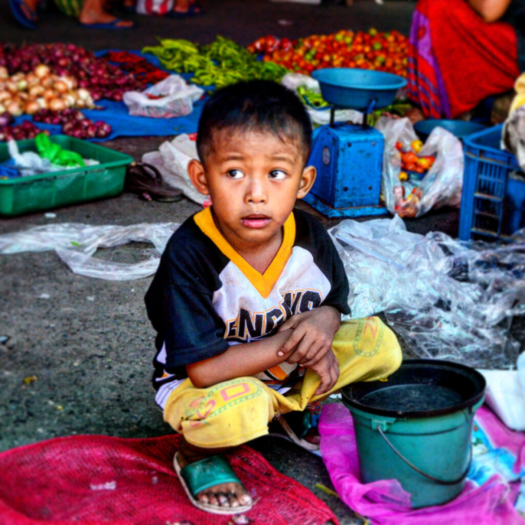 a picture of a young child already working in the market