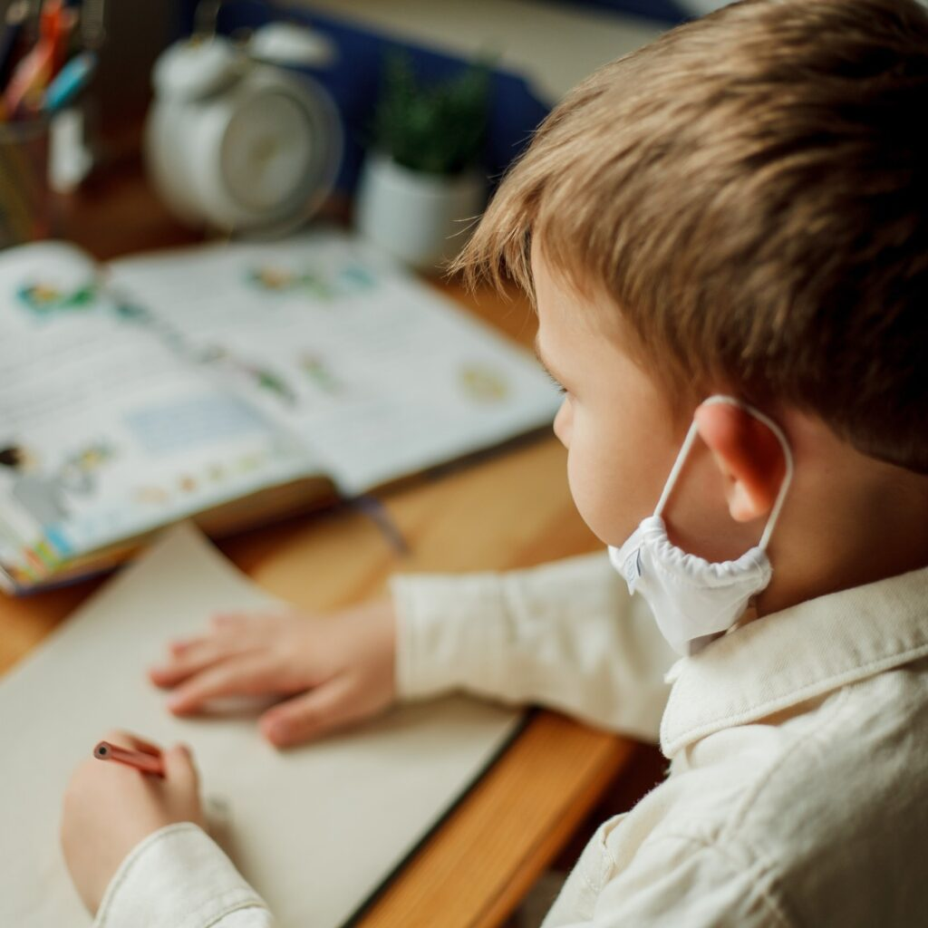 young boy attending online classes amid the Covid pandemic
